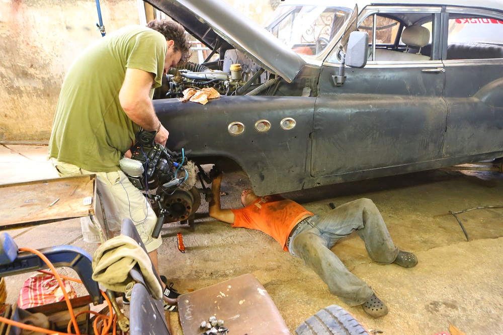 Filming mechanic Buick Roadmaster Havana Cuba