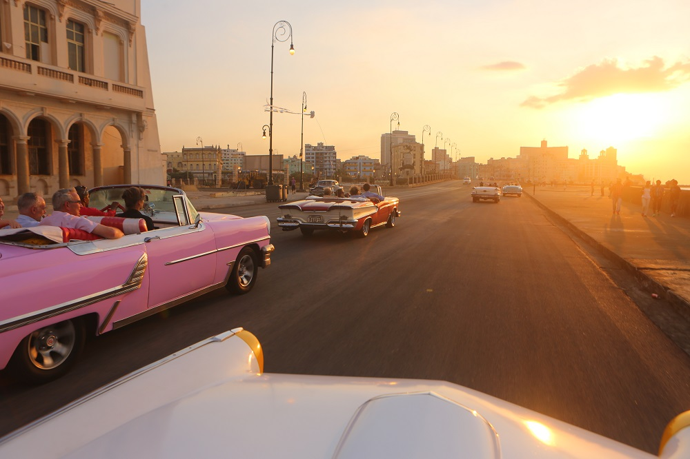 US visitors classic American cars Malecon Havana Cuba